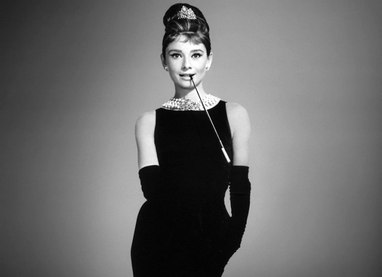 actress with black dress and pearls